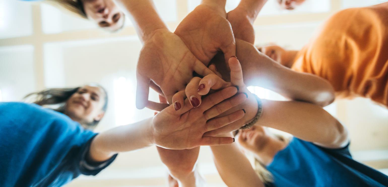 Team Hände im Kreis